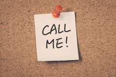 Call Me. Text message on the bulletin board Royalty Free Stock Images