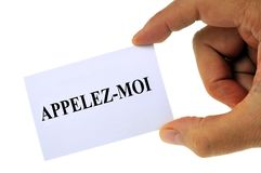 Call me written in French on a card stock photography