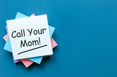 Call Mom - A message asking or reminding you to call your mom. Parenting Concept.  royalty free stock image