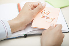 Call mommy text on adhesive note Stock Photography