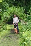 Call of Nature. Peaceful Forest Walk as man with Spaniel pauses to listen to the calls of Nature and take in the Beauty Stock Images