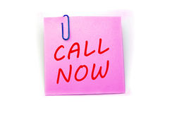 Call Now phrase. 'Call Now' phrase on a pink post-it note isolated in white Royalty Free Stock Photos