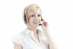 Call operator with headset. Portrait of a pretty young female call or telephone operator with a headset or headphones Royalty Free Stock Photography