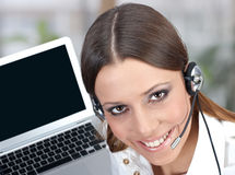 Call service. Friendly call service operator with charming smile Royalty Free Stock Photo