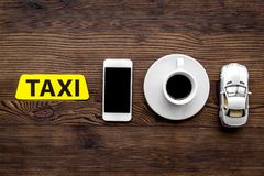 Call a taxi with mobile app and cup of coffee wooden table background top view copyspace stock photos