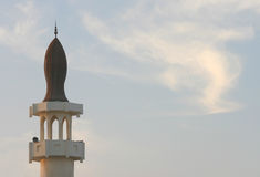 Call to prayer. A mosque in Qatar at sunset - the time for the evening prayer call and - during the holy month of Ramadan - the Iftar meal - breaking the Ramadan Stock Photo