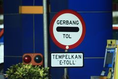 Call the toll gate. Indonesia traffic toll road signs that must be obeyed and should not be violated Royalty Free Stock Photo