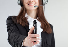 Call us!. Call center operator woman reaching out mobile phone to client asking to call Royalty Free Stock Image