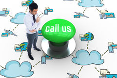 Call us against digitally generated green push button Royalty Free Stock Photos