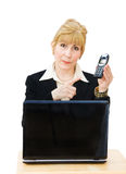 Call us - businesswoman pointing to phone. Call us - smiling businesswoman pointing to telephone and ready to receive telephone queries Royalty Free Stock Images