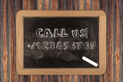 Call us - chalkboard Royalty Free Stock Images