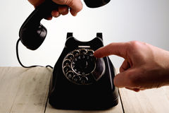 Call us. Hand that picks up the phone royalty free stock photography