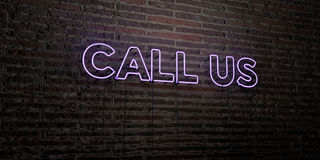 CALL US -Realistic Neon Sign on Brick Wall background - 3D rendered royalty free stock image Stock Photography