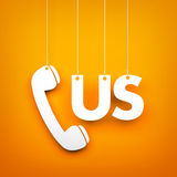 CALL US - word hanging on orange background Royalty Free Stock Images