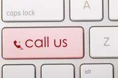 CALL US. Word written on computer keyboard Stock Photos
