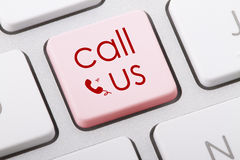 CALL US. Word written on computer keyboard Stock Image