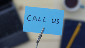 Call us written Stock Images