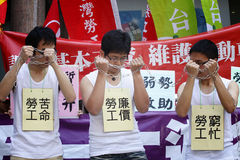 Call for wage hike. Calls for pay raises continued on April 20 as dozens of labor representatives staged a protest in Taipei, Taiwan for a minimum wage hike to Royalty Free Stock Images