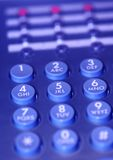 Call waiting. Close up in blue of phone lights flashing and a keypad stock images