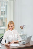 Call Waiting. Young and beautiful woman businessman holding a ce Stock Photo