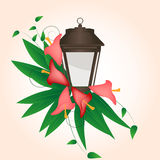 Calla flower and lantern. Streetlight entwined flowers calla lilies with leaves Royalty Free Stock Photography