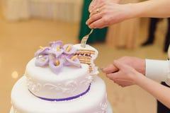 Calla Wedding Cake. Slice of tasty wedding cake Stock Images