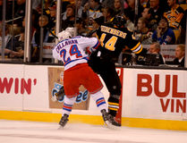 Callahan checks Seidenber, Rangers v. Bruins NHL Stock Image