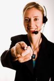 Callcenter. Beautiful young woman with telephone headset and lovely smile Royalty Free Stock Photo