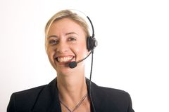 Callcenter. Beautiful young woman with telephone headset and lovely smile Stock Photos