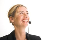 Callcenter. Beautiful young woman with telephone headset and lovely smile Stock Image