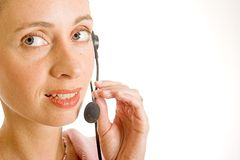 Callcenter. Beautiful young woman with telephone headset and lovely smile Royalty Free Stock Image
