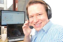 Callcenter. Male customer service representative smiling Stock Photos