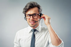 Operator with headset. Callcenter operator giving advice via telephone Royalty Free Stock Images