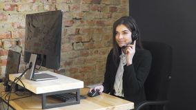 Callcenter operator in office stock video footage