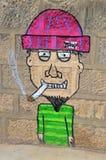 Calle Art Man Smoking Foto de archivo libre de regalías