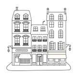 Calle con tres edificios y tiendas imagen de archivo libre de regalías