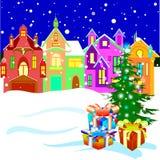Calle de la ciudad del invierno con el árbol de navidad y los regalos Fotos de archivo