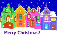 Calle de la ciudad del invierno con Feliz Navidad de las palabras Foto de archivo libre de regalías