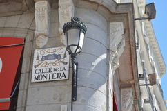 Calle de La Montera Sign and Royal Lamp Head in the streets of Madrid, Spain Stock Images