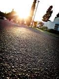 Calle de la vecindad en la puesta del sol Foto de archivo libre de regalías