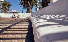 Calle de San Telmo, Puerto de la Cruz, Tenerife, Spain - October 27, 2018: The working place of a street artist photographed royalty free stock photography