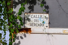 Calle del Mercado. Street sign in old San Juan, Puerto Rico. The sign reads calle del mercado Merchant's Street in English. Its located in the wall of a Royalty Free Stock Photos