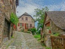 Calle en el pueblo de Conques Imagen de archivo libre de regalías