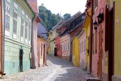 Calle medieval de Sighisoara, Rumania Foto de archivo