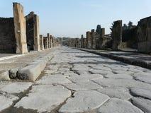 Calle principal en la ciudad romana antigua de Pompeii Fotografía de archivo libre de regalías