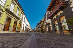Calle Real de la Plaza, Teror, Spain. Teror, Spain - February 27, 2018: Calle Real de la Plaza, main pedestrian street with traditional canarian architecture and Stock Image