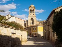 Calle Real - Hontanas. Calle Real and the bell tower of the 16th century parish church of the Conception - Hontanas, Castile and Leon, Spain, 14 September 2014 royalty free stock photography