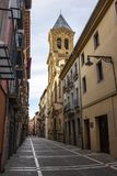 Calle San Agustin, San Agustin Street in Pamplona, Spain with the tower of St. Augustine Church in the background. Calle San Agustin, San Agustin Street with the royalty free stock photo
