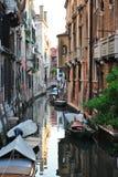 Calle veneciana con los barcos Imagen de archivo