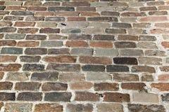 Calle vieja de la piedra del adoquín Foto de archivo libre de regalías